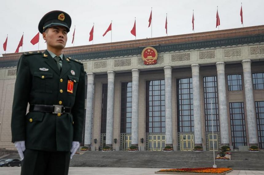 A Chinese People's Liberation Army (PLA) soldier stands guard in front of the Great Hall of the People on Oct 25, 2017.