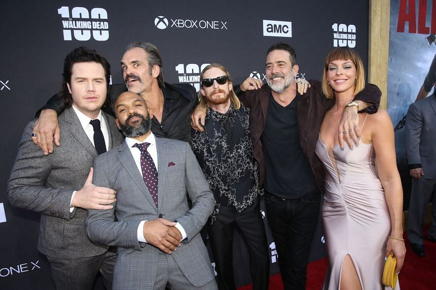 (From left) Actors Josh McDermitt, Khary Payton, Steven Ogg, Austin Amelio, Jeffrey Dean Morgan and Pollyanna McIntosh at the premiere of The Walking Dead's new eighth season, the first episode of which is also the show's landmark 100th episode.