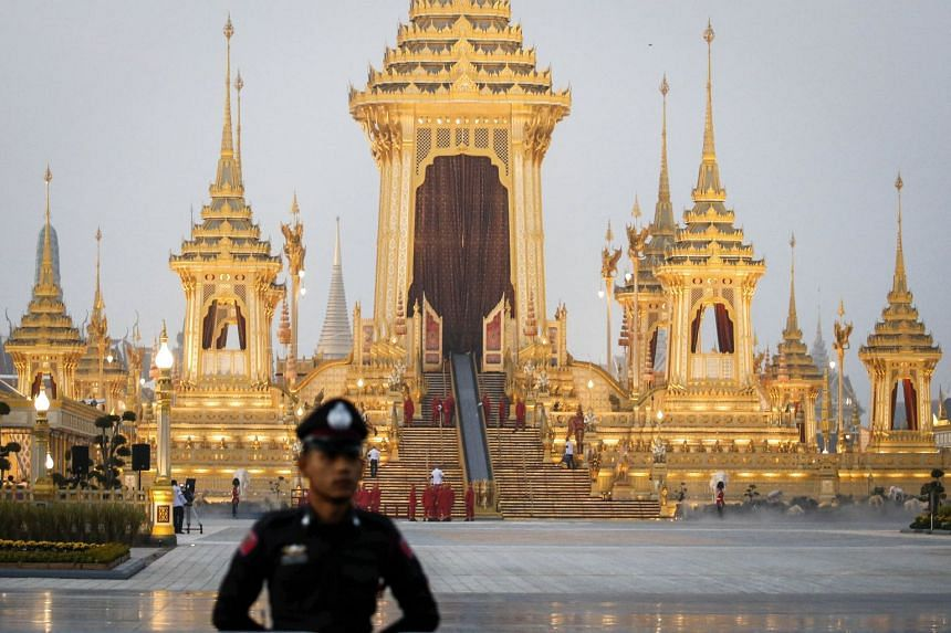 A Thai police officer stands guard during the preparations for the royal cremation ceremony outside the Royal Crematorium at Sanam Luang in Bangkok, Thailand.