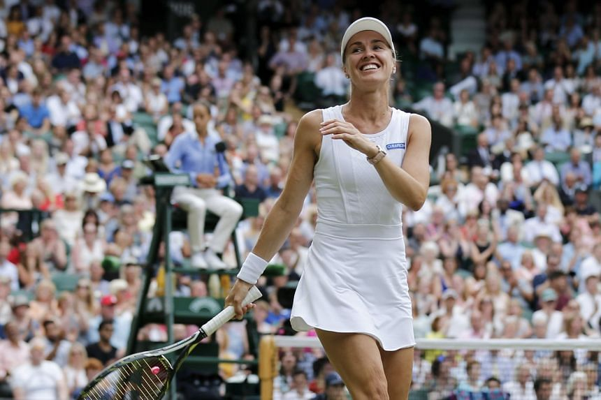 Martina Hingis reacts during the mixed doubles final with Jamie Murray of Great Britain at Wimbledon in July 2017.