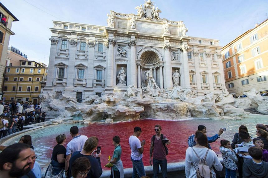 The Trevi fountain's waters run red.