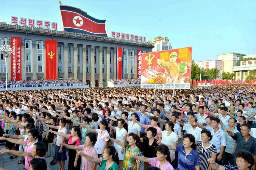 North Koreans participate in a mass pro-government rally in Pyongyang on Aug 9, 2017.