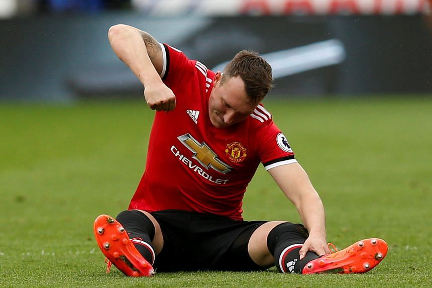 Phil Jones looks dejected after sustaining an injury on Oct 21, 2017.