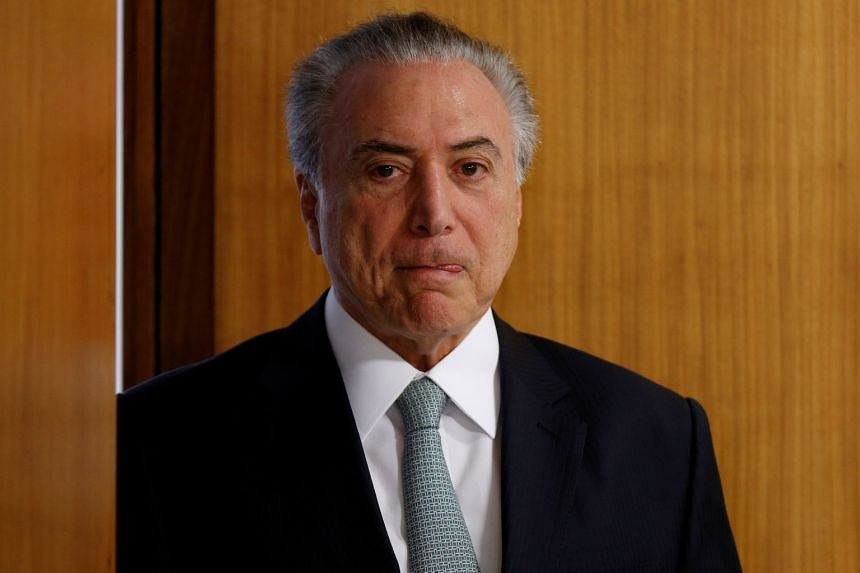 Temer arrives for a ceremony at the Planalto Palace in Brasilia, Oct 26, 2017.