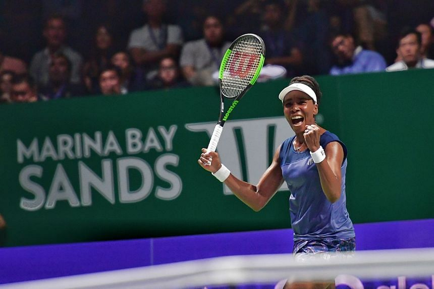 A jubilant Venus Williams after beating Garbine Muguruza 7-5, 6-4 at the Singapore Indoor Stadium on Oct 26, 2017 to qualify for the semi-finals of the WTA Finals.