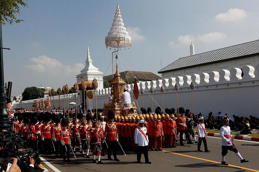 Royal guards carrying the royal urn of Thai King Bhumibol Adulyadej during a cremation procession from the Grand Palace in Bangkok yesterday.