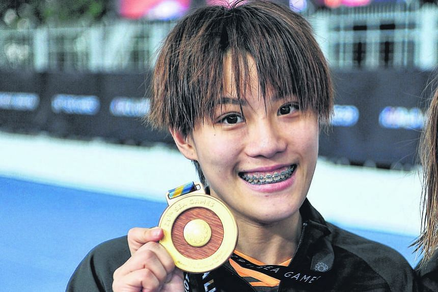 Malaysian diver Wendy Ng Yan Yee emerged yesterday as the athlete who had failed a doping test. Should she be stripped of her two titles, Singapore's silver medallists Ashlee Tan and Fong Kay Yian are then likely to claim gold.