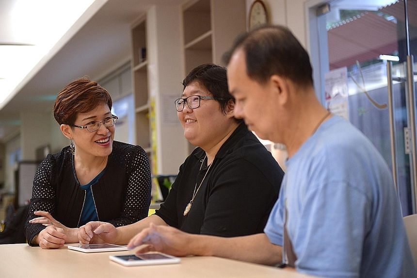 Dr Catherine Dong (far left), who designed the Stroke Support Station's brain health and memory training programme, with stroke survivors Denise Hu, 32, and Liew Teck Chye, 64, at the Enabling Village in Lengkok Bahru.