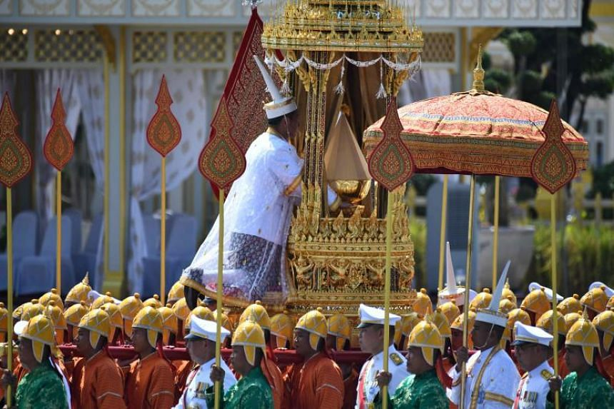 A royal palanquin is carried by soldiers during a procession to transfer the royal relics and ashes of Thailand's late King Bhumibol Adulyadej from the crematorium to the Grand Palace in Bangkok on Oct 27, 2017.
