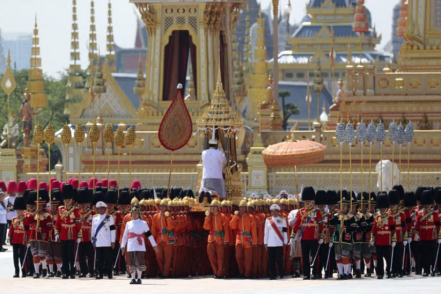 A royal palanquin is carried by soldiers during a procession to transfer the royal relics and ashes of Thailand's late King Bhumibol Adulyadej from the crematorium to the Grand Palace in Bangkok.