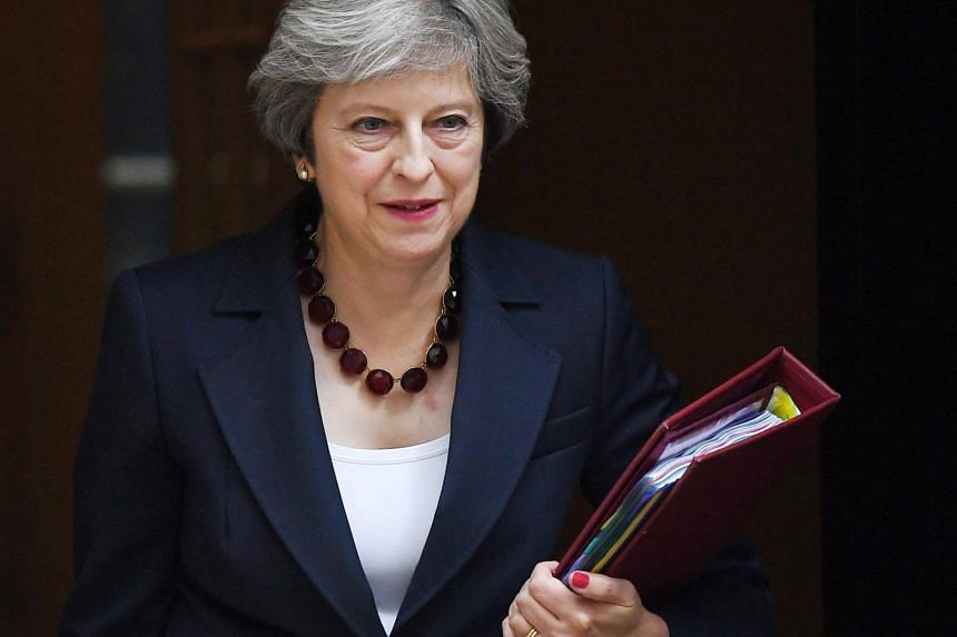 British Prime Minister Theresa May departs from 10 Downing Street in London, Britain, on Oct 25, 2017.