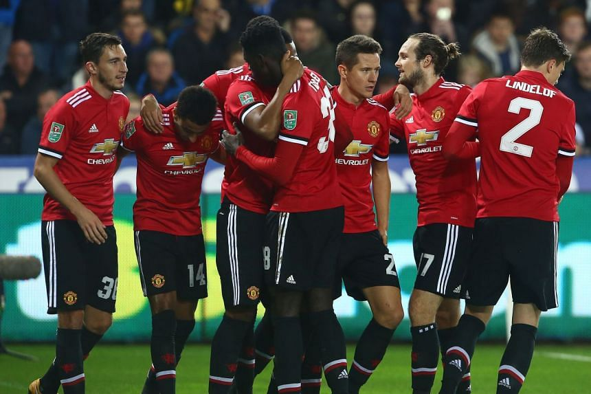 Manchester United's Jesse Lingard (second left) celebrates a League Cup goal with team mates.
