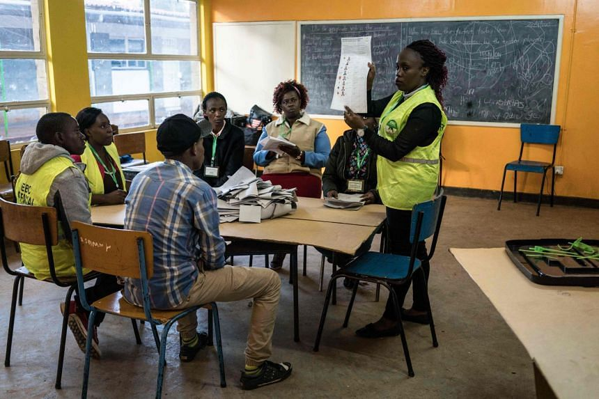 Officials count ballots at a polling station in a primary school in Lavington, a suburb of Nairobi, where 660 voters are registered and where only 177 persons voted on Oct 26, 2017.