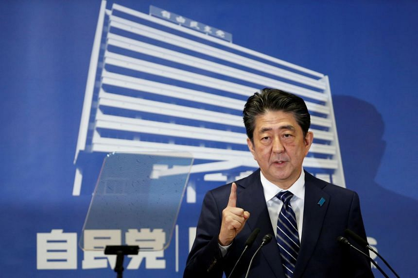 Japan's Prime Minister Shinzo Abe, who is also leader of the Liberal Democratic Party (LDP), attends a news conference at LDP headquarters in Tokyo.