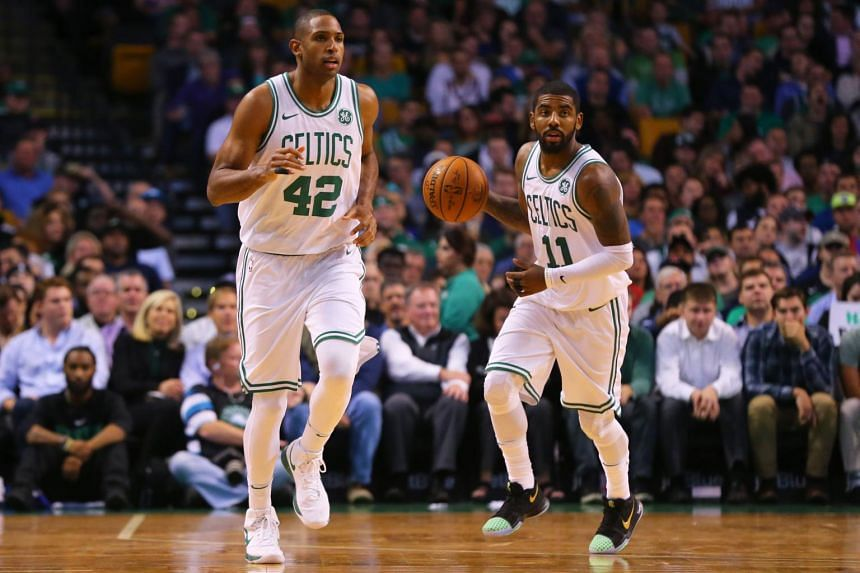 Kyrie Irving #11 of the Boston Celtics dribbles past Al Horford #42 during the first half against the New York Knicks.