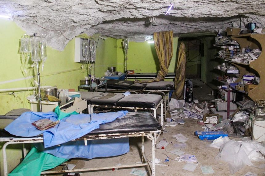 A file photo taken on April 4 shows destruction at a hospital room in Khan Sheikhun following a suspected toxic gas attack.