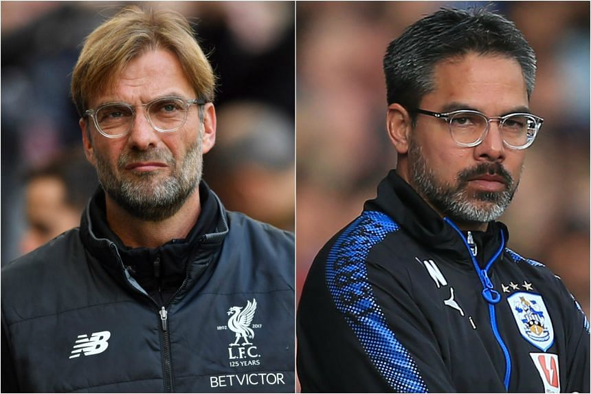 David Wagner (right) is looking to defeat Jurgen Klopp when Huddersfield meets Liverpool.