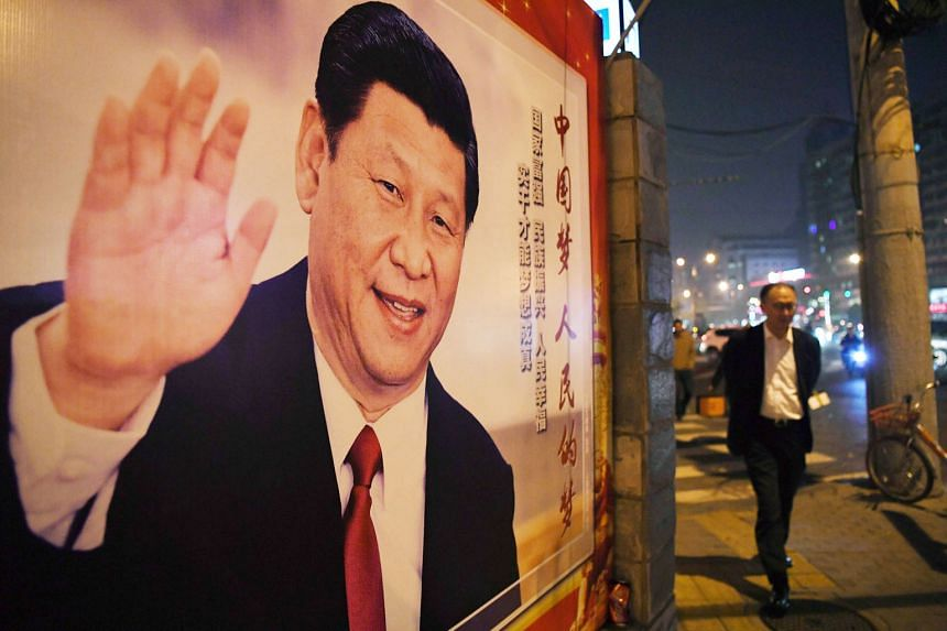 A poster of Chinese President Xi Jinping in Beijing. Mr Xi had conspicuously left out any mention of a gross domestic product target in his work report.