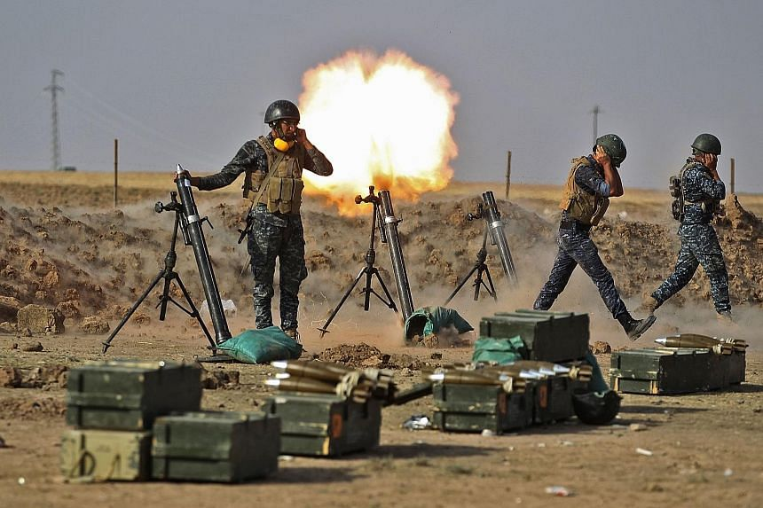 Iraqi forces firing mortars on the Kurdish Peshmerga near the area of Faysh Khabur, on the Turkish and Syrian borders, in the Kurdish autonomous region on Thursday.