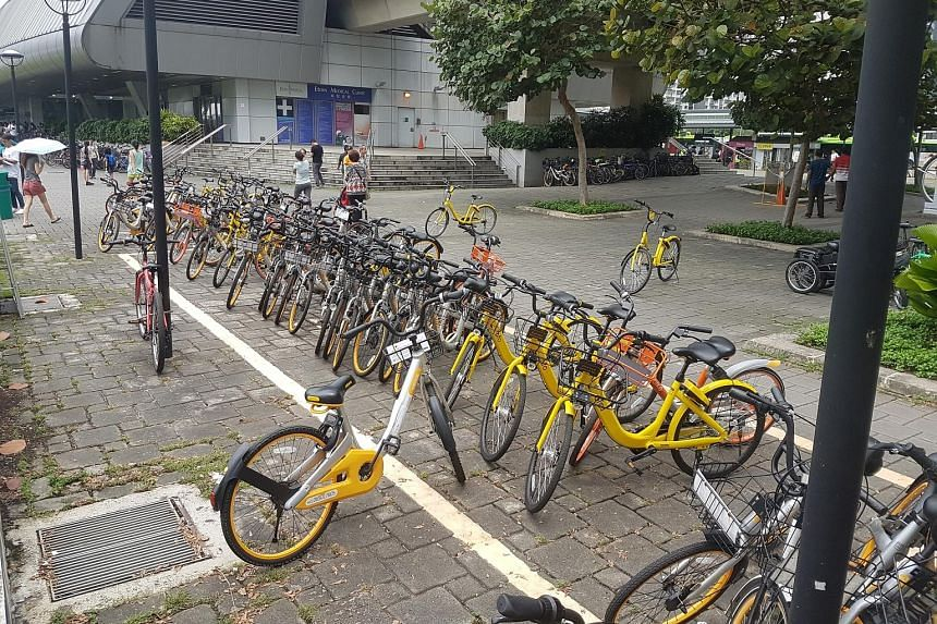 Shared bicycles parked at and around designated bicycle parking zones outside the Punggol MRT station. The various bike-sharing firms are ramping up the use of geofencing.