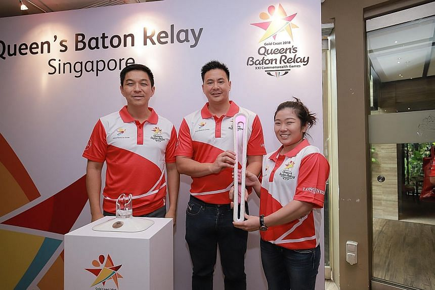 From left: Singapore National Olympic Council president Tan Chuan-Jin, 2018 Commonwealth Games chef de mission Mark Chay and assistant CDM Lim Heem Wei with the Queen's Baton yesterday. The Queen's Baton arrived from Brunei yesterday and will head to