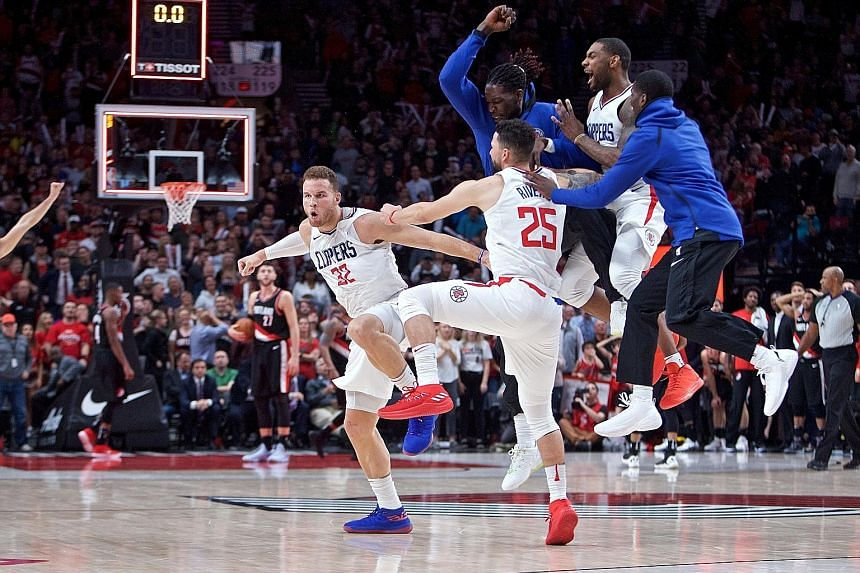 LA Clippers forward Blake Griffin (left) celebrating after his game-winning three-point basket against the Portland Trail Blazers just before time expired on Thursday. The Clippers improved to 4-0.