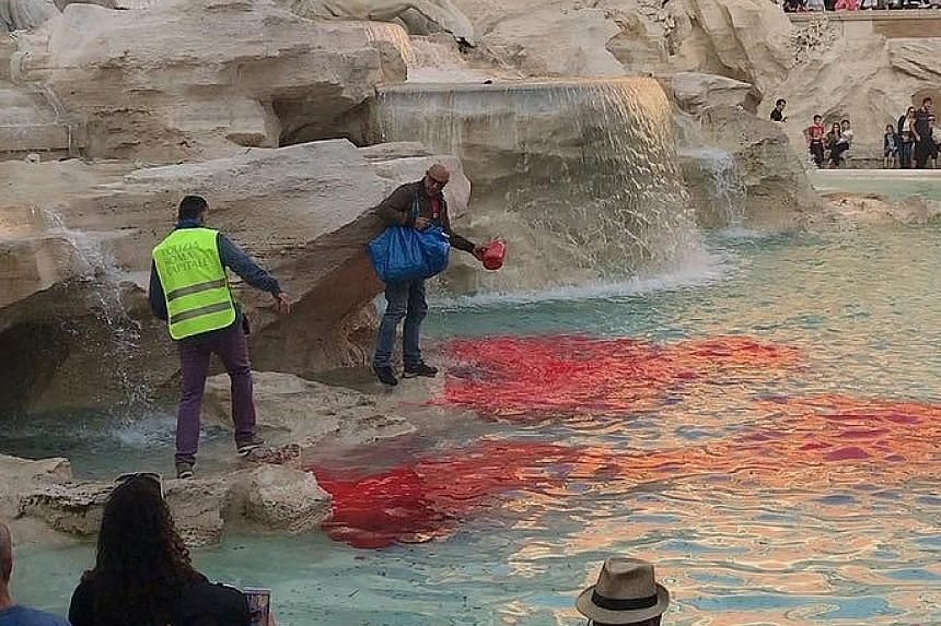 The waters of Rome's Trevi Fountain, one of Italy's top tourist attractions, turned red on Thursday after a man dumped dye into the main pool. Police detained the man, a statement from the mayor's office said, as city officials assessed if there had