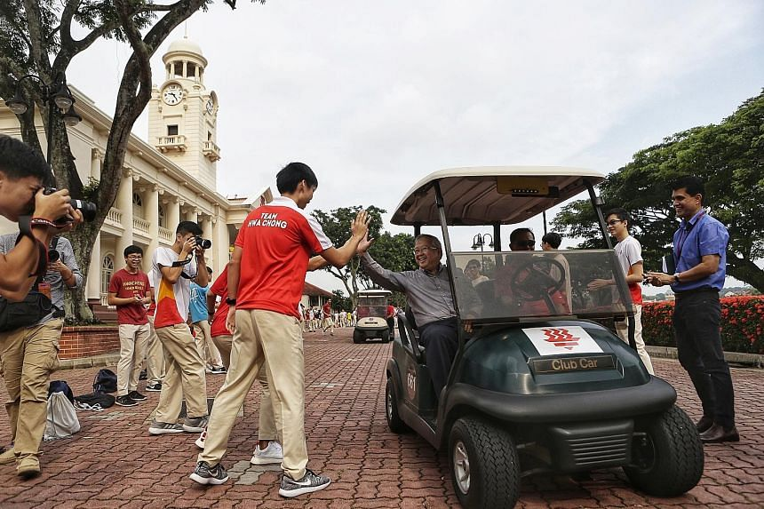 Hwa Chong Institution students and staff saying goodbye to outgoing principal Hon Chiew Weng yesterday. Student council president Gui Ming Jiang says they will miss seeing him drive his buggy across the school grounds.