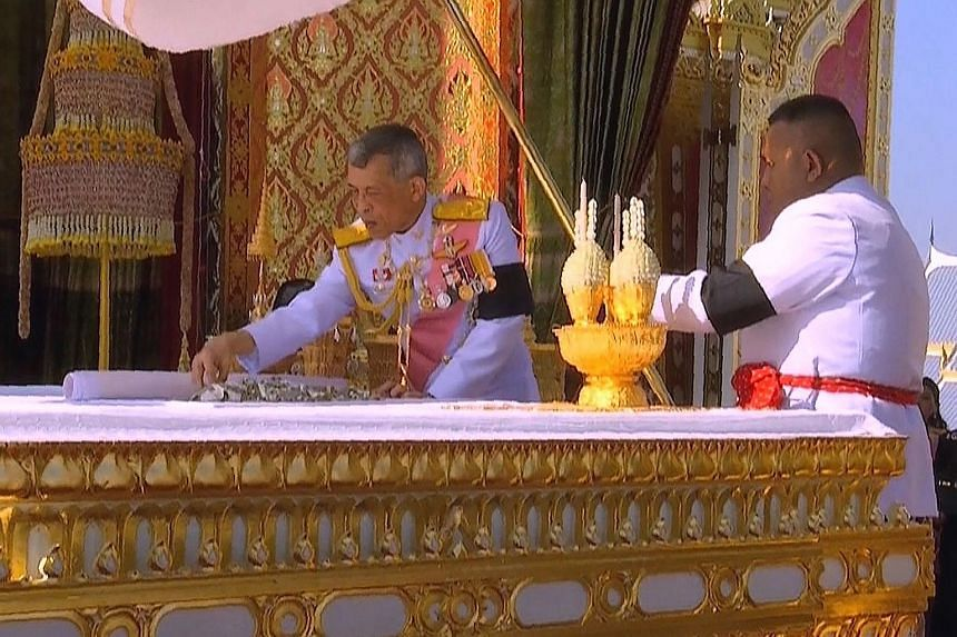 Thai King Maha Vajiralongkorn taking part in a ceremony where he selected relics from the ashes of his father, the late Thai king Bhumibol Adulyadej, at the Royal Crematorium in Bangkok.