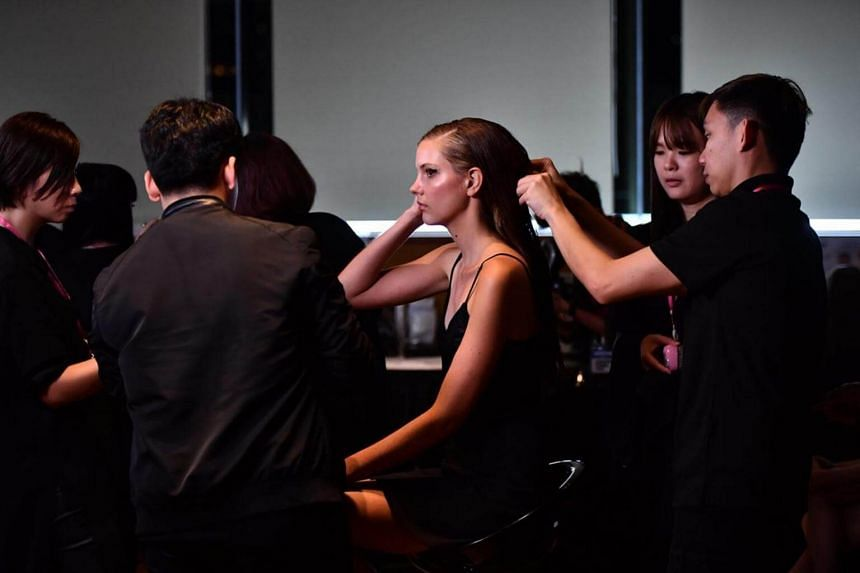 Model getting ready for the Presentation of the Spring 2018 Collection by Jason Wu, at National Gallery Singapore on Oct 28, 2017.