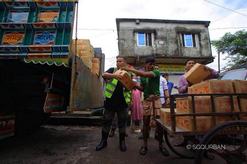 Mr Muhammad Firdaus, 36,helps transfer boxes of aid containing items such as food and water on Oct 25.