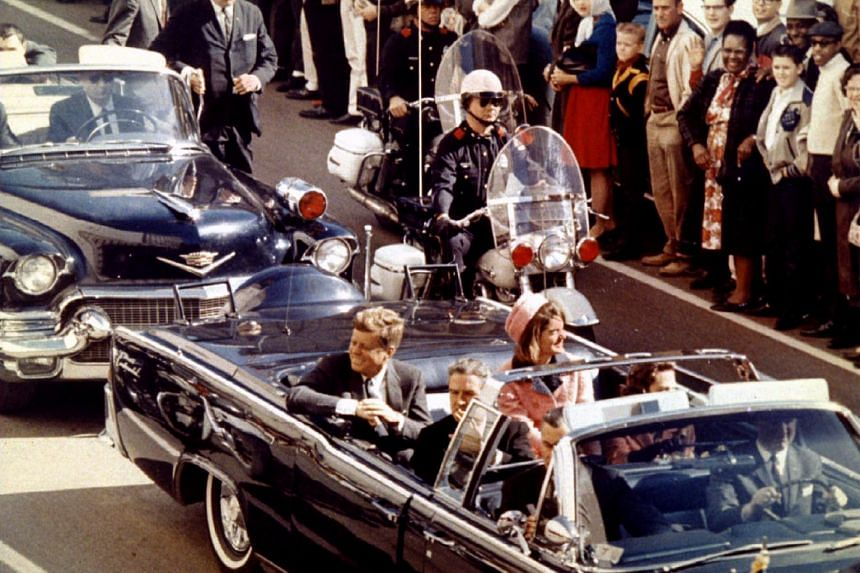 US President John F. Kennedy, First Lady Jaqueline Kennedy and Texas Governor John Connally ride in a liousine moments before Kennedy was assassinated, on Nov 22, 1963.