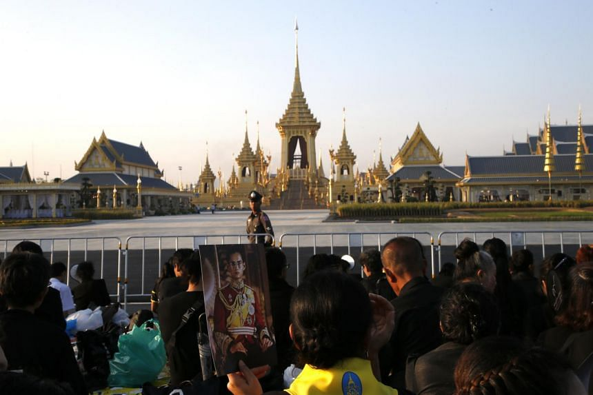 Thai mourners await the royal relics and royal ashes collection ceremony as part of the late Thai King Bhumibol Adulyadej's cremation ceremony at the Royal Crematorium in Bangkok, Thailand.