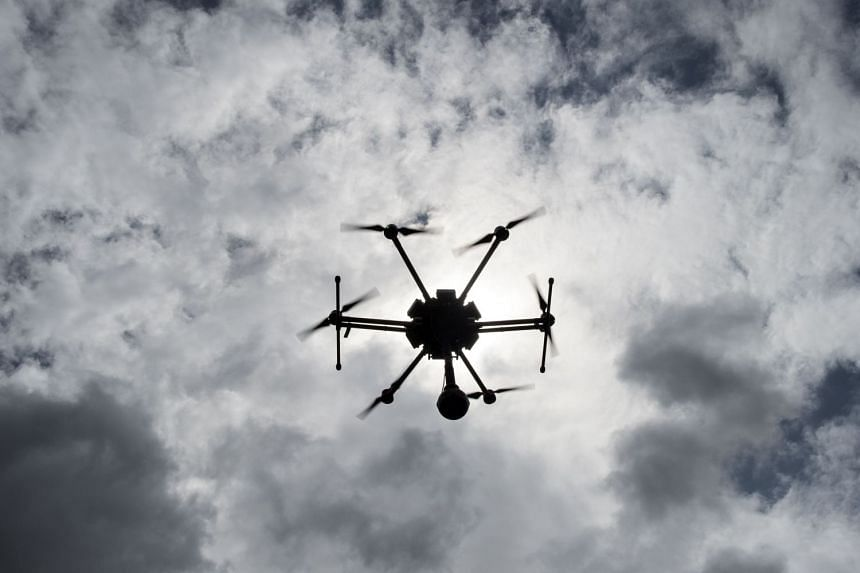 The journalists, from Singapore and Malaysia, were detained for flying a drone near the parliament compound.