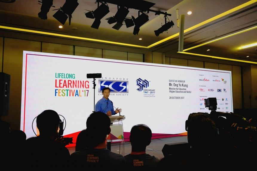 Education Minister (Higher Education and Skills) Ong Ye Kung announcing the launch of the SkillsFuture Series at the Lifelong Learning Festival at the Devan Nair Institute.