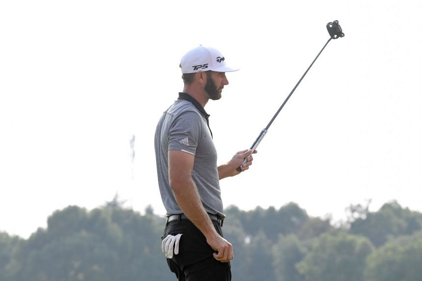 World No. 1 Dustin Johnson finishing with a flourish – a birdie on the 18th hole in the second round of the WGC-HSBC Champions in Shanghai. The American took to his new putter immediately with a wonderful nine-under 63 yesterday which gave him a on