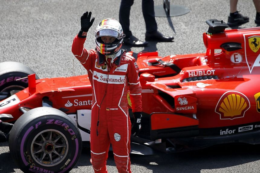 Vettel  celebrates getting pole position for the Mexico Grand Prix.