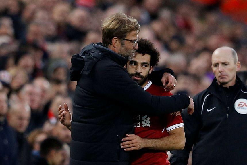 Klopp embraces Mohamed Salah after he is substituted off.