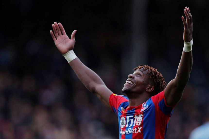Crystal Palace's Wilfried Zaha celebrates scoring their second goal.