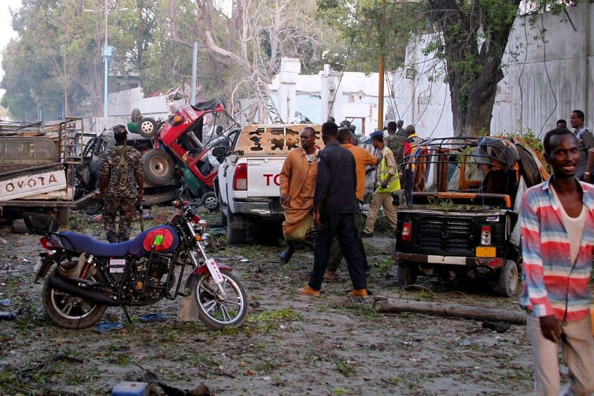 A general view shows the scene after a suicide car bomb explosion at the gate of Nasahablod Two Hotel.