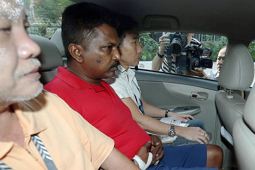 Krishnan Raju was arrested at the Woodlands Checkpoint after he surrendered himself.