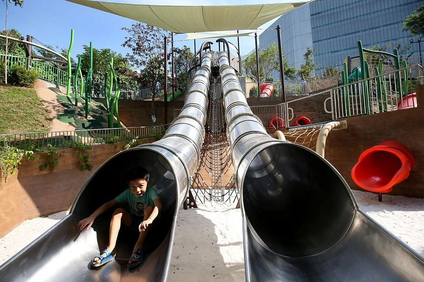A young visitor trying out Singapore's longest and tallest tube slide in a public park. National Parks Board said it made use of the area's undulating terrain to come up with unique designs.