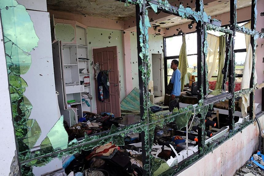 A member of Marawi's security forces inspecting a damaged room in Isnilon Hapilon's hideout. The terrorist's death in a military operation on Oct 16 was the catalyst for the end of the Philippines' longest and most intense urban battle in recent hist