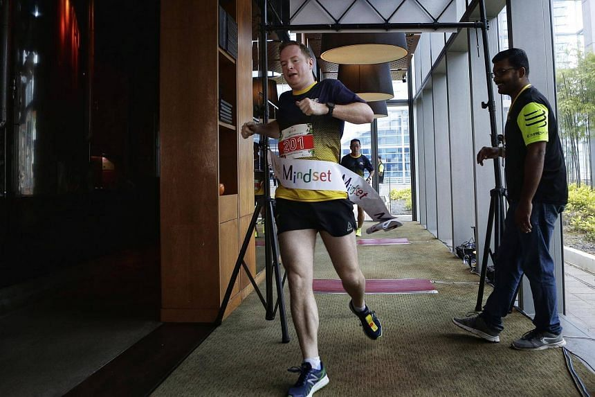 Mr Haslam Preeston, 41-year-old regional managing director of Jardine Cycle & Carriage, completing the vertical race up the 33-floor Marina Bay Financial Centre (MBFC) Tower 1 during the Mindset Challenge and Carnival 2017.