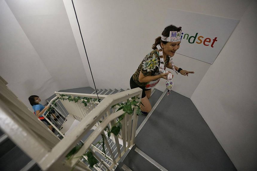 Ms Dora Chua, 48-year-old receptionist with Jardine Cycle and Carriage, participating in the vertical race up the 33-floor Marina Bay Financial Centre (MBFC) Tower 1 in her jungle-themed outfit during the Mindset Challenge and Carnival 2017.