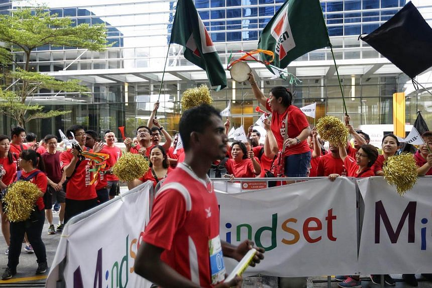 Cheerleaders from participating companies cheering their runners competing in the vertical race up the 33-floor Marina Bay Financial Centre (MBFC) Tower 1 during the Mindset Challenge and Carnival 2017.