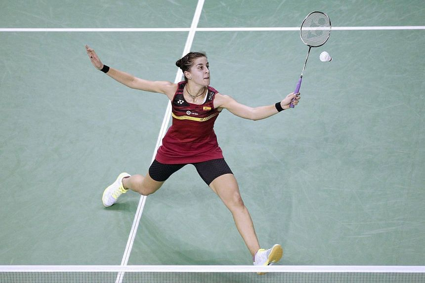 Carolina Marin in action during her Women's Single match at the Yonex Badminton French Open tournament at the Stade de Coubertin in Paris.