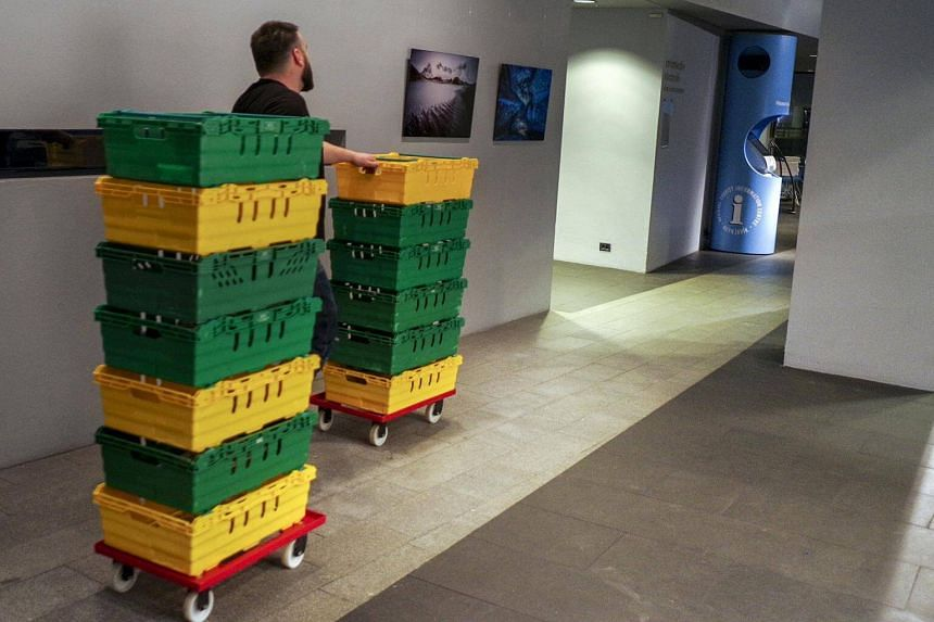 An official delivers boxes with the votes for the counting during a snap parliamentary election in Reykjavik, Iceland.