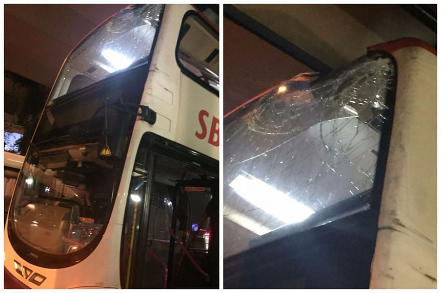 The impact shattered the windshield of the SBS Transit bus' upper deck.