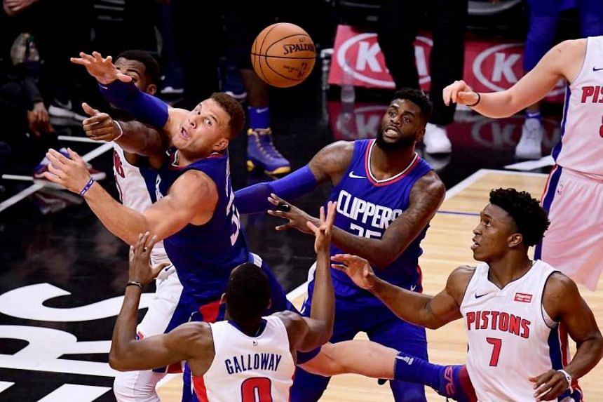 Los Angeles Clippers forward Blake Griffin fighting for the ball against Detroit Pistons Langston Galloway (#9) and Stanley Johnson (#7) during their NBA match on Oct 28, 2017.